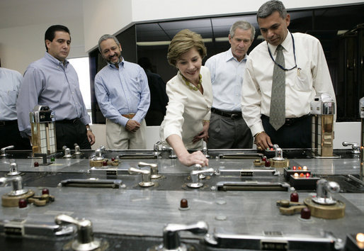 Laura Bush with President George W. Bush turns a knob during a tour of the operations center of the Panama Canal's Miraflores Locks in Panama City, Panama, Monday, Nov. 7, 2005. White House photo by Eric Draper