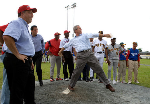 President George W. Bush delivers a pitch from the mound during a baseball event with Major League baseball players and Panamanian youth, Monday, Nov. 7, 2005 in Panama City, Panama. White House photo by Eric Draper