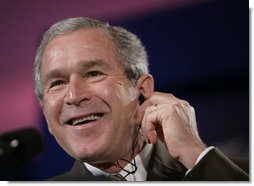 President George W. Bush reacts during a joint press availability with the President Martin Torrijos of Panama at Casa Amarilla in Panama City, Panama, Monday, Nov. 7, 2005. White House photo by Eric Draper