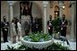 President George W. Bush and Mrs. Bush are welcomed Monday, Nov. 7, 2005, by Panama's President Martin Torrijos and his wife, Vivian, -- and a pet bird -- at the Palacio de Las Garzas in Panama City, Panama. White House photo by Krisanne Johnson