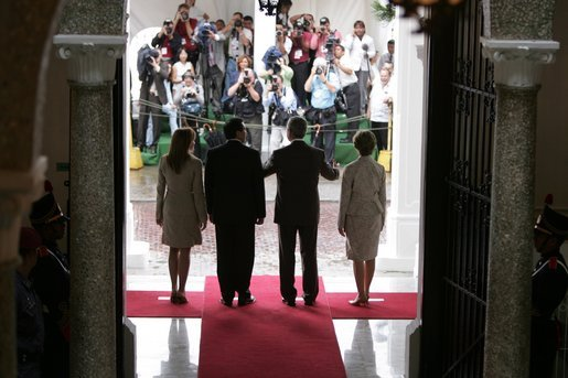 President and Mrs. Bush and President Martin Torrijos of Panama, and Mrs. Torrijos, face the media after the Bush's arrival Monday, Nov. 7, 2005, at the Palacio de Las Garzas in Panama City, Panama. White House photo by Paul Morse