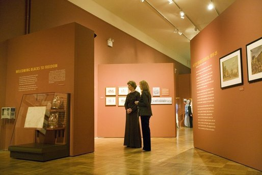 "First Lady Laura Bush is lead by Dr. Louise Mirrer through a display of ""Catherine Ferguson"", part of the Slavery in New York exhibition currently running, after attending a New York History Makers Gala at the New York Historical Society in New York, NY, Tuesday, Nov. 8, 2005. White House photo by Shealah Craighead"