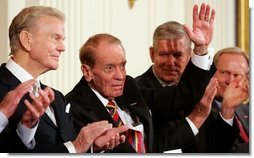 Former Mississippi Congressman and decorated war veteran, G.V. Sonny Montgomery, center, waves as he is introduced, and applauded by his fellow recipients of the 2005 Presidential Medal of Freedom, awarded Wednesday, Nov. 9, 2005 in the East Room. From left to right are, Paul Harvey, Montgomery, General Richard B. Myers and golf legend Jack Nicklaus.  White House photo by Shealah Craighead
