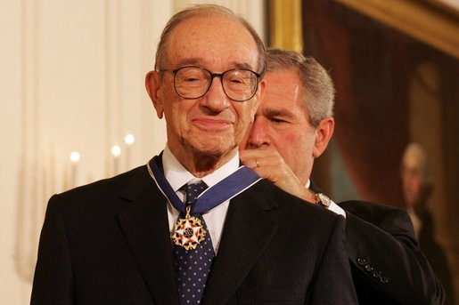 President George W. Bush presents the Presidential Medal of Freedom to Federal Reserve Chairman Alan Greenspan, one of 14 recipients of the 2005 Presidential Medal of Freedom, awarded Wednesday, Nov. 9, 2005 in the East Room of the White House. White House photo by Shealah Craighead
