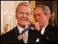 President George W. Bush presents the Presidential Medal of Freedom to legendary radio personality Paul Harvey, one of 14 recipients of the 2005 Presidential Medal of Freedom, awarded Wednesday, Nov. 9, 2005 in the East Room of the White House. White House photo by Shealah Craighead