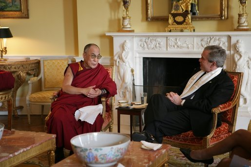 President George W. Bush, wearing a scarf presented to him by the Dalai Lama, meets with the Buddhist spiritual leader Wednesday, Nov. 9, 2005, in the private residence of the White House. White House photo by Paul Morse