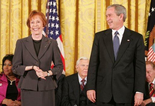 Carol Burnett jokes with President George W. Bush during the presentation of the Presidential Medal of Freedom to in the East Room Wednesday, Nov. 9, 2005. As a singer, dancer, comedienne, and actress, she has been one of America's most cherished entertainers since her Broadway by in 1959. White House photo by Paul Morse