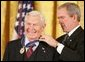 President George W. Bush presents the Presidential Medal of Freedom to actor Andy Griffith, one of 14 recipients of the 2005 Presidential Medal of Freedom, awarded Wednesday, Nov. 9, 2005 in the East Room. White House photo by Paul Morse
