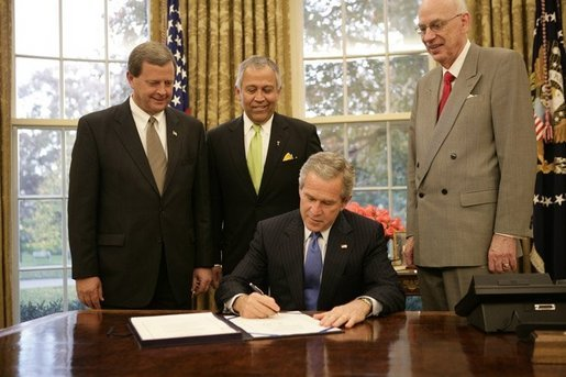 President George W. Bush is backed by U.S. Rep. Tom Latham, R-Iowa, left, U.S. Rep. Henry Bonilla, R-Texas, center, and U.S. Sen. Robert Bennett, R-Utah, Thursday, Nov. 10, 2005 in the Oval Office, as he signs H.R. 2744-Agriculture, Rural Development, Food and Drug Administration, and Related Agencies Appropriations Act, 2006. White House photo by Eric Draper