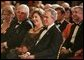 President George W. Bush and Mrs. Laura Bush listen to the evening's entertainment at the White House, Thursday, Nov. 10, 2005, following the dinner celebrating the 40th Anniversary of the National Endowment for the Arts and the National Endowment for the Humanities. White House photo by Paul Morse