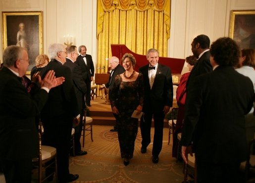 President George W. Bush and Mrs. Laura Bush are applauded at the conclusion of festivities at the White House, Thursday, Nov. 10, 2005, following the evening's celebration of the 40th Anniversary of the National Endowment for the Arts and the National Endowment for the Humanities. White House photo by Paul Morse