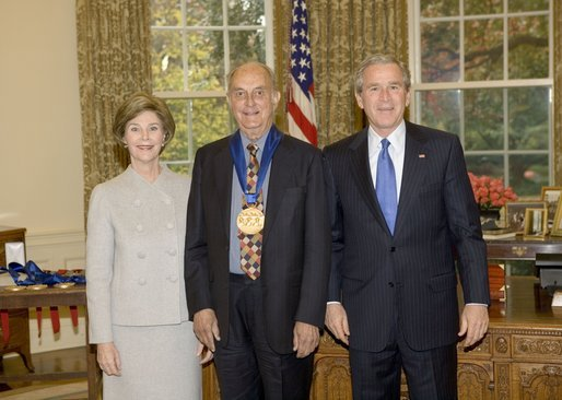 President George W. Bush and Laura Bush stand with author Louis Auchincloss, recipient of the 2005 National Medal of Arts, in the Oval Office Thursday, Nov. 10, 2005. White House photo by Eric Draper
