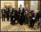 President George W. Bush stands with recipients of the 2005 National Medal of Arts winners Thursday, Nov. 9, 2005, in the Oval Office. Among those recognized for their outstanding contributions to the arts were, from left: Leonard Garment, arts advocate; Louis Auchincloss, author; Paquito D'Rivera, jazzist; James De Preist, symphony conductor; Tina Ramirez, choreographer; Robert Duval, actor, and Ollie Johnston, animator. White House photo by Eric Draper