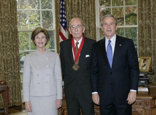 President George W. Bush and Laura Bush stand with 2005 National Humanities Medal recipient Walter Berns, historian, Thursday, Nov. 10, 2005 in the Oval Office at the White House. White House photo by Eric Draper