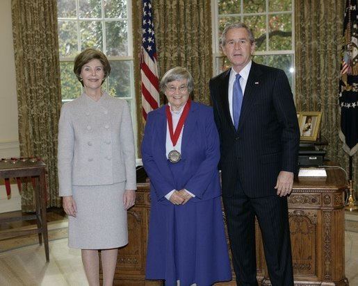 President George W. Bush and Laura Bush stand with 2005 National Humanities Medal recipient Eva Brann, professor at St. John's College, Thursday, Nov. 10, 2005 in the Oval Office at the White House. White House photo by Eric Draper
