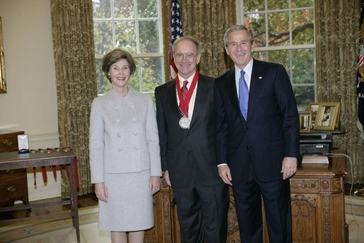 President George W. Bush and Laura Bush stand with 2005 National Humanities Medal recipient John Lewis Gaddis, historian, Thursday, Nov. 10, 2005 in the Oval Office at the White House. White House photo by Eric Draper