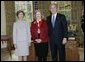 President George W. Bush and Laura Bush stand with 2005 National Humanities Medal recipient Mary Ann Glendon, legal scholar, Thursday, Nov. 10, 2005 in the Oval Office at the White House. White House photo by Eric Draper