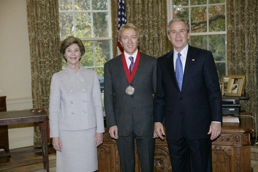 President George W. Bush and Laura Bush stand with 2005 National Humanities Medal recipient Leigh Keno, art historian and appraiser, Thursday, Nov. 10, 2005 in the Oval Office at the White House. White House photo by Eric Draper