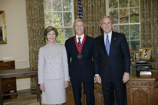 President George W. Bush and Laura Bush stand with 2005 National Humanities Medal recipient Leslie Keno, art historian and appraiser, Thursday, Nov. 10, 2005 in the Oval Office at the White House. White House photo by Eric Draper