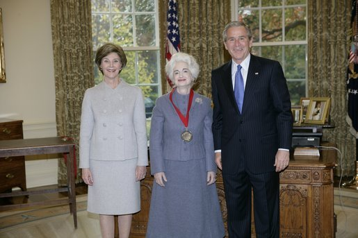 President George W. Bush and Laura Bush stand with 2005 National Humanities Medal recipient Judith Martin, author and columnist, Thursday, Nov. 10, 2005 in the Oval Office at the White House. White House photo by Eric Draper
