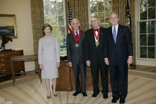 President George W. Bush and Laura Bush stand with 2005 National Humanities Medal recipients Lewis Lehrman and Richard Gilder, Thursday, Nov. 10, 2005 in the Oval Office at the White House. White House photo by Eric Draper
