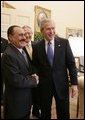 President George W. Bush welcomes Yemen President Ali Abdullah Saleh into the Oval office of the White House, Thursday, Nov. 10, 2005. Interpreter Gamal Helal is seen in background. White House photo by Eric Draper