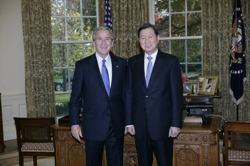 President George W. Bush welcomes newly appointed South Korean Ambassador to the United States, Lee Tae-sik, to the Oval Office at the White House, Thursday, Nov. 10, 2005. White House photo by Eric Draper