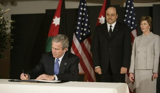 President George W. Bush and Mrs. Laura Bush, visit the Embassy of Jordan to sign a book of condolence, Thursday, Nov. 10, 2005 in Washington, in remembrance of those killed in the terrorist attacks, Wednesday, in Jordan. White House photo by Eric Draper