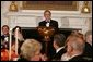 President George W. Bush welcomes guests in the State Dining Room of the White House, Thursday, Nov. 10, 2005, at the dinner celebrating the 40th Anniversary of the National Endowment for the Arts and the National Endowment for the Humanities. White House photo by Paul Morse