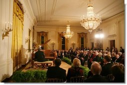 President George W. Bush, Mrs. Laura Bush and guests listen to the evening's entertainment at the White House, Thursday, Nov. 10, 2005, following the dinner celebrating the 40th Anniversary of the National Endowment for the Arts and the National Endowment for the Humanities.  White House photo by Paul Morse