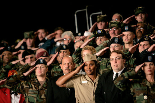 Staff and Army personnel welcome President George W. Bush, during his introduction, Friday, Nov. 11, 2005 at the Tobyhanna Army Depot in Tobyhanna, Pa. White House photo by Eric Draper