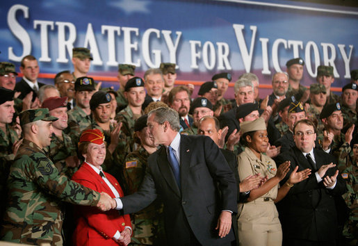 President George W. Bush greets the audience after delivering remarks on the war on terror, Friday, Nov. 11, 2005 at the Tobyhanna Army Depot in Tobyhanna, Pa. White House photo by Eric Draper