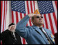 Veterans Jose Garcia, right, and John Rowan, salute Friday, Nov. 11, 2005, during Veterans Day ceremonies at Arlington National Cemetery in Arlington, Va. White House photo by David Bohrer