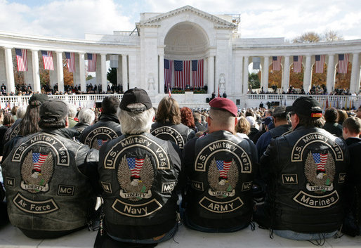 A group of men wearing vests honoring the various branches of the Armed Forces, attend ceremonies Friday, Nov. 11, 2005, during Veterans Day events at Arlington National Cemetery in Arlington, Va. White House photo by David Bohrer