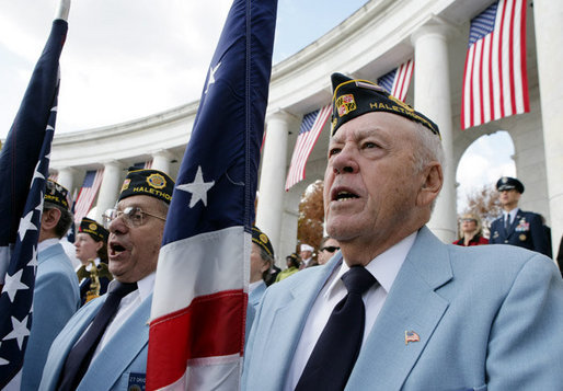 Veteran Dewey Lowman of Post 109 in Halethorpe, Md., right, is seen Friday, Nov. 11, 2005, during Veterans Day ceremonies at Arlington National Cemetery in Arlington, Va. White House photo by David Bohrer