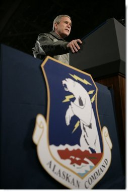 President George W. Bush speaks from the podium inside Hangar One at Elmendorf Air Force Base Monday, Nov. 14, 2005, during his remarks on the War on Terror. The Anchorage stop was his first of a seven-day trip to Asia.  White House photo by Eric Draper