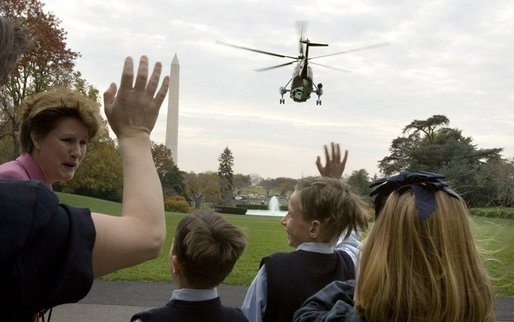 As President Bush departs the South Lawn on Marine One, emotions fly high for families following their meeting with the President and Laura Bush Monday, Nov. 14, 2005. President Bush left for a week-long trip to Asian countries. White House photo by Lynden Steele