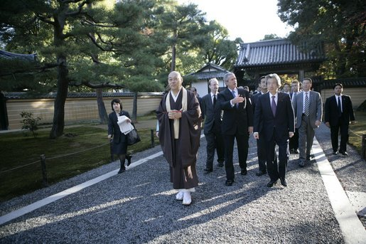 President George W. Bush and Japan's Prime Minister Junichiro Koizumi join the Reverend Raitei Arima, Chief Priest of the Golden Pavilion Kinkakuji Temple in Kyoto, Japan, Wednesday, Nov. 16, 2005. White House photo by Eric Draper