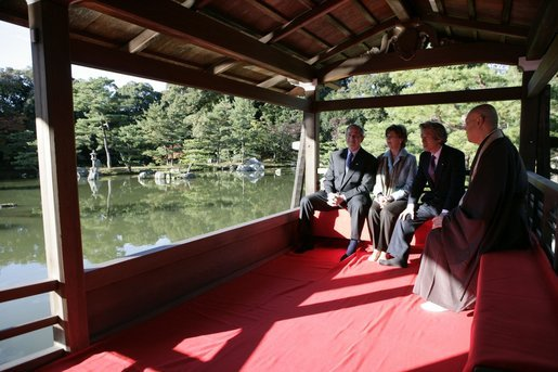President George W. Bush, Mrs. Bush, Japan's Prime Minister Junichiro Koizumi and the Reverend Raitei Arima, Chief Priest of the Golden Pavilion Kinkakuji Temple, pause during a cultural visit to the temple Wednesday, Nov. 16, 2005, in Kyoto. White House photo by Eric Draper