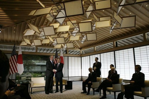 President George W. Bush and Prime Minister of Japan, Junichiro Koizumi, shake hands, Wednesday, Nov. 16, 2005, upon meeting at the Kyoto State Guest House in Kyoto, Japan. White House photo by Eric Draper