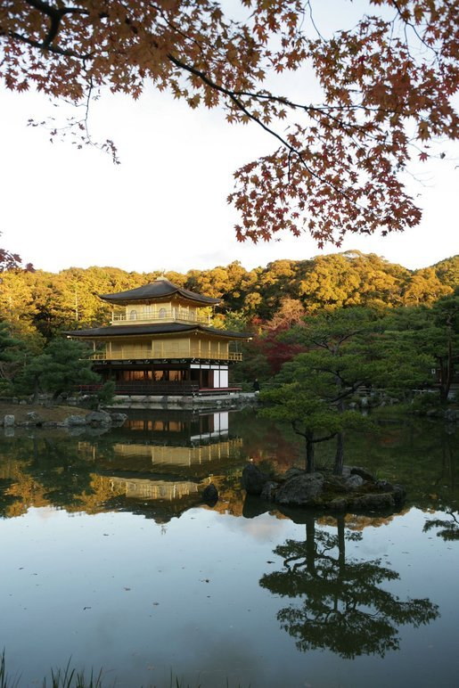 The Golden Pavilion Kinkakuji Temple is reflected in the pool as the sun rises over Kyoto, Japan, Wednesday, Nov. 16, 2005. White House photo by Paul Morse