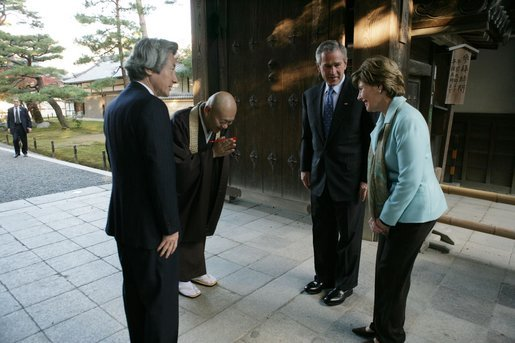 President and Mrs. Bush are greeted by the Reverend Raitei Arima, Chief Priest at the Golden Pavilion Kinkakuji Temple, and Japan's Prime Minister Junichiro Koizumi, at the doors of the temple Wednesday, Nov. 16, 2005, in Kyoto. White House photo by Paul Morse