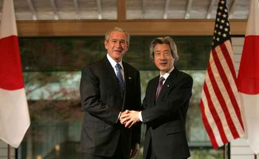 President George W. Bush and Prime Minister Junichiro Koizumi of Japan, shake hands Wednesday, Nov. 16, 2005, prior to their meeting at the Kyoto State Guest House in Kyoto, Japan. White House photo by Paul Morse