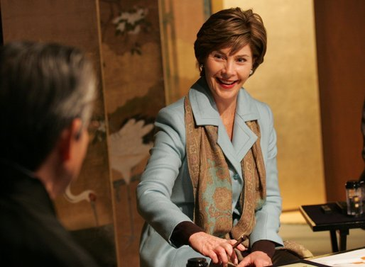 Mrs. Laura Bush smiles during an exchange Wednesday, Nov. 16, 2005, with Master Minoru Sawada, head calligraphy master of the Origin Arts Program, at the Suchiya-cho Townhouse in Kyoto, Japan. White House photo by Shealah Craighead
