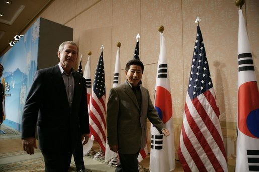 President George W. Bush and Moo Hyun Roh, President of the Republic of Korea, leave the stage at the Hotel Hyundai in Gyeongju, Korea Thursday, Nov. 17, 2005, after a joint press availability. White House photo by Eric Draper