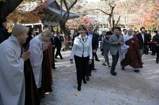 President George W. Bush and Laura Bush smile as they are greeted by monks Thursday, Nov. 17, 2005, at the Bulguksa Temple in Gyeongju, Korea. White House photo by Eric Draper