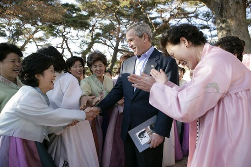 President George W. Bush greets excited participants Thursday, Nov. 17, 2005, during his tour of the Bulguksa Temple in Gyeongju, Korea. White House photo by Eric Draper