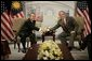 President George W. Bush and Prime Minister Abdullah Ahmad Badawi of Malaysia, exchange handshakes during their meeting Thursday, Nov. 17, 2005, at the Chosun Westin Hotel in Busan, Korea. White House photo by Eric Draper