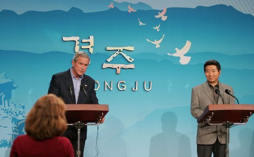 President George W. Bush and Moo Hyun Roh, President of the Republic of Korea, listen to a question from a reporter Thursday, Nov. 17, 2005, during a joint press availability at the Hotel Hyundai in Gyeongju, Korea. White House photo by Paul Morse