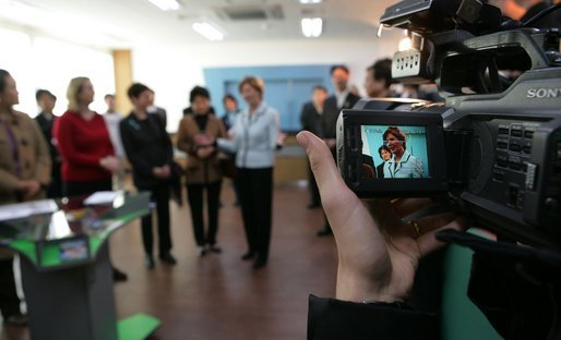 The liquid crystal display of a video camera captures Mrs. Laura Bush as she visits one of three classrooms Thursday, Nov. 17, 2005, at the Gyeongju English Village in Gyeongju, Korea. White House photo by Shealah Craighead